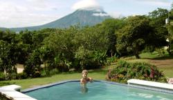 Lounging in the pool overlooking Lake Nicaragua and Conception Volcano