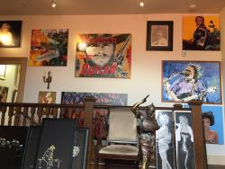 Gallery recently moved to 10051 West River Street, just across the rail road tracts from prior l