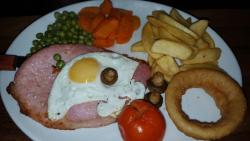 Gammon steak with egg, onion rings and chips