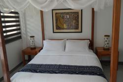 Four poster bed with hotel standard mattress