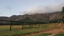 Behind the braai area, right up against the mountains