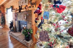 Christmas is Here Come Enjoy our Holiday Decorated Cabins