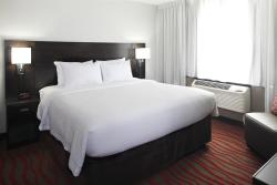 King Suite Room with Separated Living Area is available at the Courtyard in St Cloud