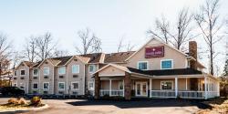 Holmes Suites & Inn