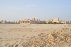 The beach with the hotel in the background