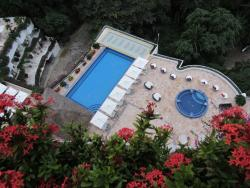view of the lower pools, the pool with the bar is closer in to the hotel and there is a pool on