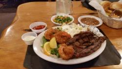 Steak and shrimp with sides