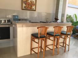Outdoor kitchenette & dining area