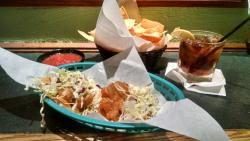 Taco Tuesday mahi mahi tacos and a happy hour well drink