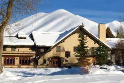 The Sun Valley Inn in the snow on a sunny day