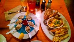 oyster shooters with artichoke dip and an IPA
