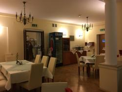 The dining area is small and can accommodate about 25 people.
