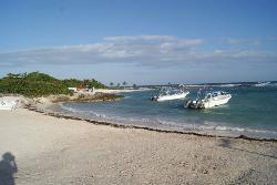 View on beach with wedding venue on far beach.
