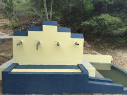 functioning water spigots and adjacent pond for animals