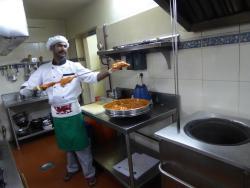 The chef demonstrating tandoori chicken.