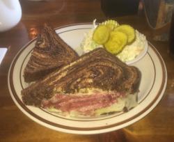 Ruben sandwich with side of coleslaw