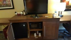 Mini-fridge and microwave. Coffee maker behind the TV.