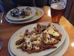 The Montreal-style poutine with clam chowder and beer at Harbour Public House