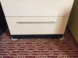 washcloth shims under dresser so drawers don't fall open