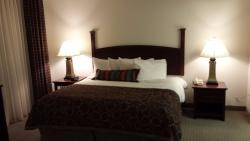 King size bed with four pillows