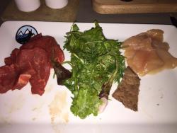Raw chicken touching salad!