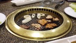 Selection of meats, fish and seafood that you cook yourself on little BBQs.
