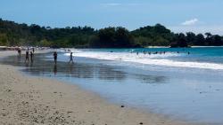 Beach looking left. Busiest day of the week. Manuel Antonio Park beach is top right