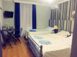 Room #6. Standard 3 beds, private bathroom with cold and hot water, heating and satellite TV. Fr