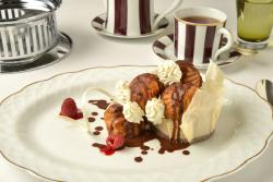 Deliciously filled profiteroles with ice cream & chocolate sauce at the Grill restaurant.