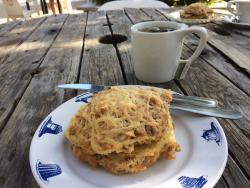 Breakfast sandwich and cappuccino