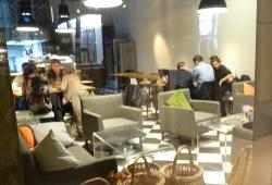 Comfortable sofas or woden tables to eat and drink