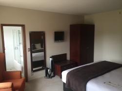 Bedroom in refurbished Deluxe Room