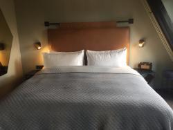 A comfy bed in a comfy room