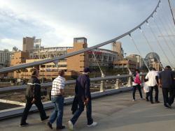 Pedestrian footbridge to Petco Park and Gaslamp District. Adjacent to hotel.