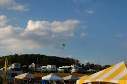 Parachuter dropping in during festival.