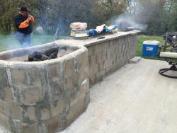 Fire pit and grill in the back of the hotel