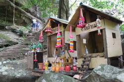 Spirit Houses along the trail to the falls
