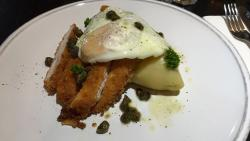 OMG! The chicken schnitzel with bacon & smoked cheddar mash, fried egg and caper butter sauce on