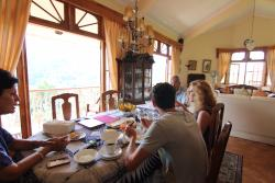 Having breakfast with our hosts