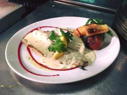 pan fried fillet of seabass in a white wine and tarragon sauce