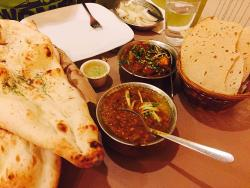 Butter naan, Daal Tadka (special order), Chicken-do-pyaza and Papad (from left to right)