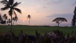 Sunset. Ocean in distance. View from activity pool area.