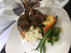 The Lamb. Beautiful presentation, plus delicious side of potatoes