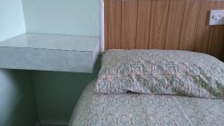 Shelf at side of bed
