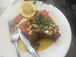 Tuna on stone with fresh garlic