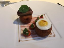 Croquettes of Suckling Pig, Fried Quail Egg, Foie Gras, Pancetta, Red Pepper Mostardo,
