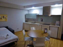 kitchen area with microwave, fridge, and stove