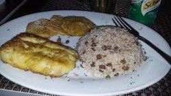 Fresh fish, peas & rice, patacones.