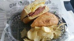 The Bateau, corner and sliced knockwurst, warmed mozzarella and mustard on french bread, delicio