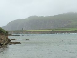 View of the remains of Ferriter's Castle (tiny blotch on the shore to far left)